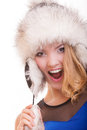 Happy blond girl in warm fur hat winter clothes fashion and beauty young woman studio shot isolated on white background Royalty Free Stock Photo