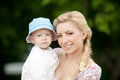 Happy blond mom one year old son enjoying nature together Royalty Free Stock Image
