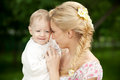 Happy blond mom one year old son enjoying nature together Royalty Free Stock Photos