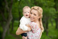 Happy blond mom one year old son enjoying nature together Stock Photography