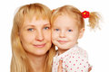 Happy blond mother and daughter faces Stock Images