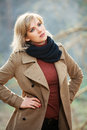 Happy blond fashion woman in autumn forest Royalty Free Stock Photo