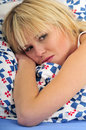 Happy blond woman lying in bed daydreaming Royalty Free Stock Photos