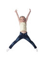 Happy blonde girl in jeans jumping Royalty Free Stock Images