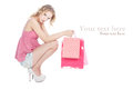 Happy blonde girl with pink shopping bags Stock Photos