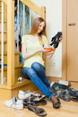 Happy blonde housewife with shoes Royalty Free Stock Photo