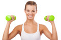 Happy blonde woman exercising with weights young girl holding smiling and showing muscles smiling girl holding and showing muscles Royalty Free Stock Images