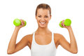 Happy blonde woman exercising with weights young girl holding smiling and showing muscles smiling girl holding and showing muscles Royalty Free Stock Image