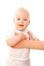 Happy blue-eyed baby standing with mother's arms Royalty Free Stock Image