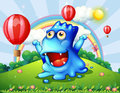 A happy blue monster at the hilltop with the floating balloons illustration of Royalty Free Stock Images