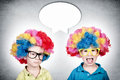 Happy and bored twin twins with the clown wig Royalty Free Stock Image