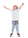 Happy boy with arms up celebrating isolated over a white background Stock Image