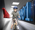 Happy boy on a bike in data center with d blue and red binary code Stock Photo