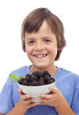 Happy boy with blackberries Royalty Free Stock Images
