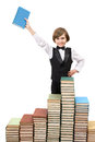 Happy boy with a book at big stack of books Royalty Free Stock Photo