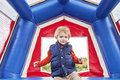 Happy boy in bounce house toddler jumping inside a Stock Photography