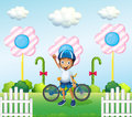 A happy boy at the candyland with his bike Royalty Free Stock Photo