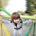 Happy boy on carousel outdoors Royalty Free Stock Photography