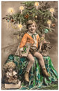 Happy boy with christmas tree, gifts and vintage toys Royalty Free Stock Photo