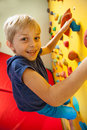 Happy boy on the climbing wall vertical Royalty Free Stock Photos