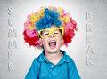 Happy boy with clown wig on summer break Stock Image