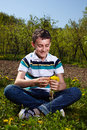 Happy boy in the countryside teen outdoor a dandelions field Stock Images