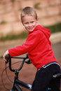 Happy boy cycling young riding his bicycle Royalty Free Stock Photo