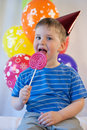 Happy boy eat lollipop soiled is eating the Stock Photo