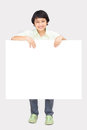 Happy boy with the empty blank paper Royalty Free Stock Image