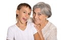 Happy boy with his grandmother granny hugging grandson on white background Stock Photos