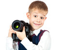 Happy Boy is holding camera and taking a photo Royalty Free Stock Photography