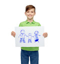 Happy boy holding drawing or picture of family Royalty Free Stock Photo