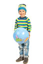 Happy boy holding inflate globe world isolated on white background Royalty Free Stock Photography