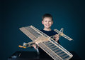 Happy boy holding the model airplane plane modeling little with wooden Stock Images