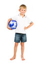 Happy boy holding soccer ball Stock Photo