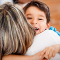 Happy boy hugging his mother Stock Image