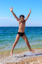 Happy boy jumping on the beach Royalty Free Stock Photo
