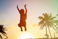 Happy boy jumping at sunset beach Royalty Free Stock Photo