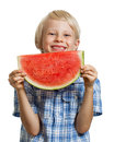 Happy boy laughing behind water melon a cute holding a juicy slice of watermelon isolated on white Royalty Free Stock Images