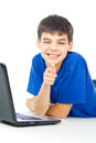Happy boy learns lessons at a laptop with Stock Images