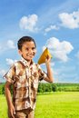Happy boy with paper plane cute little years old holding blue airplane on bright sunny day Royalty Free Stock Photo