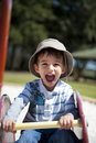 Happy Boy at Playground Stock Images