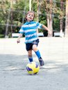 Happy boy playing football outdoor Royalty Free Stock Photography
