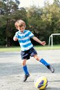 Happy boy playing football outdoor Royalty Free Stock Images