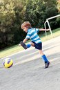 Happy boy playing football outdoor Royalty Free Stock Photos
