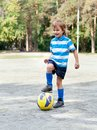 Happy boy playing football outdoor Royalty Free Stock Photo