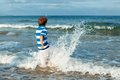 Happy boy plays on beach outdoor Stock Photography