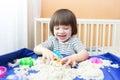 Happy Boy Plays Kinetic Sand A...