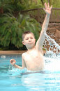 Happy boy in pool Royalty Free Stock Image
