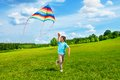 Happy boy run with kite Royalty Free Stock Photo